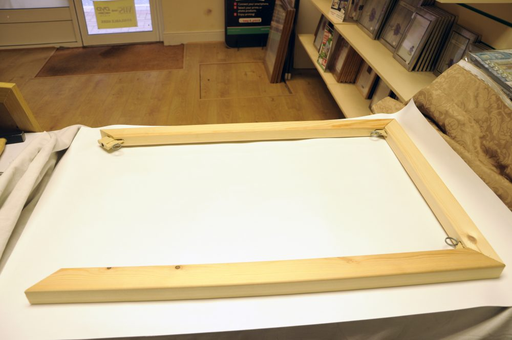 <h4> First we lay down the print and frame making sure that it is evenly sat for pinning </h4>