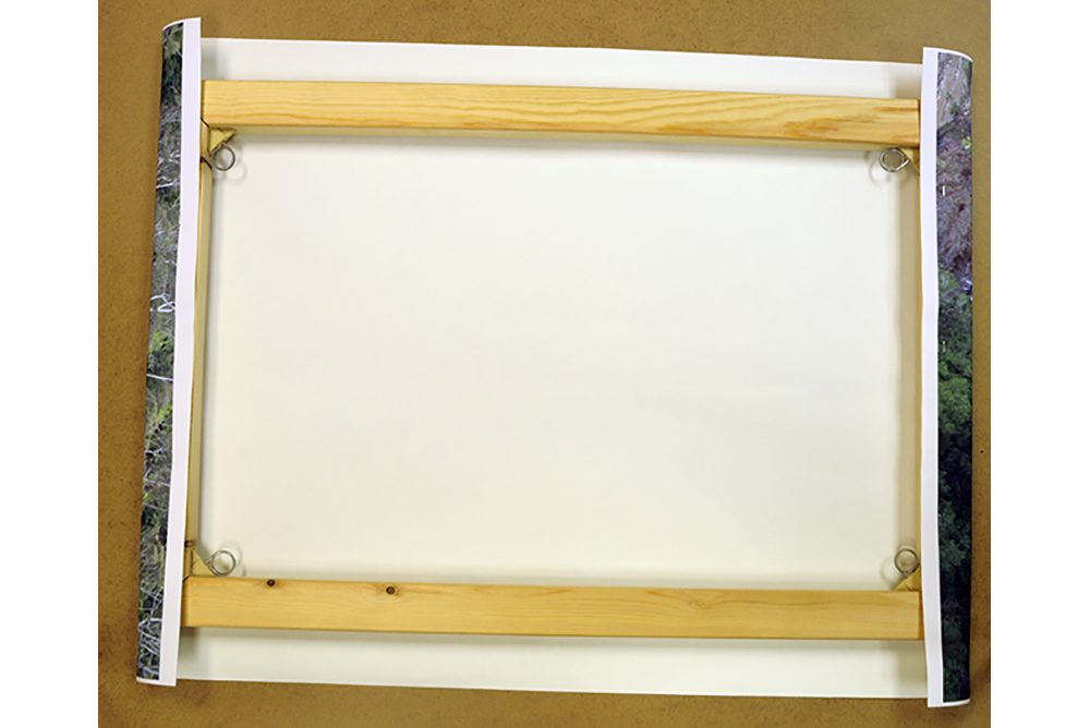 <h4>Once the frame is lined up, staples are placed in two opposite ends of the canvas frame to tension it</h4>
